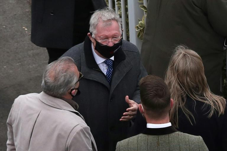 Former Manchester United manager Alex Ferguson celebrated a hat-trick of wins at Aintree