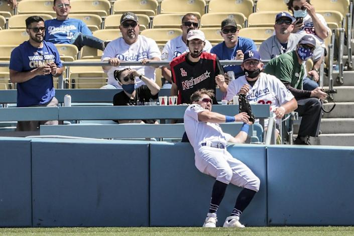Zach McKinstry slams into a wall while chasing a foul ball.
