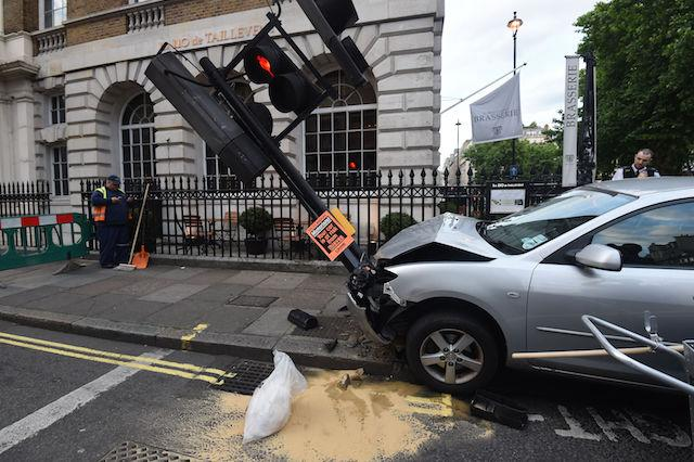 Emergency services attend the scene after a car crashed into a lamp post in Harley Street, adjacent to Cavendish Square, central London.