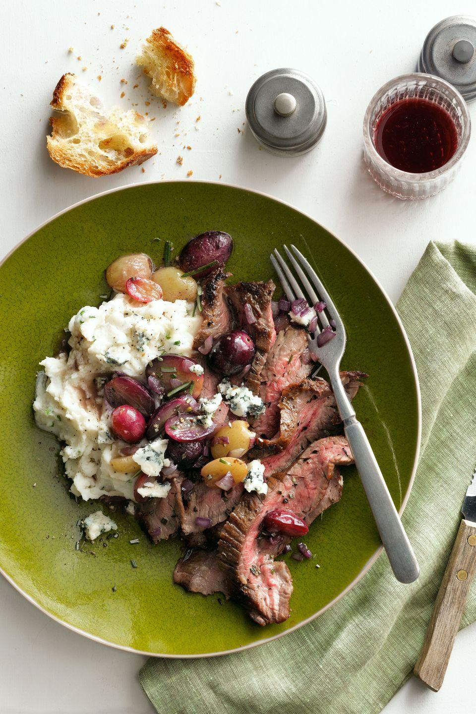 """<p>A quick and easy flank steak gets acidity from roasted grapes in this easy, weeknight recipe.</p><p><strong><a href=""""https://www.countryliving.com/food-drinks/recipes/a5748/herb-garlic-crusted-flank-steak-with-pan-roasted-grapes-recipe-clx0914/"""" rel=""""nofollow noopener"""" target=""""_blank"""" data-ylk=""""slk:Get the recipe"""" class=""""link rapid-noclick-resp"""">Get the recipe</a>.</strong></p>"""