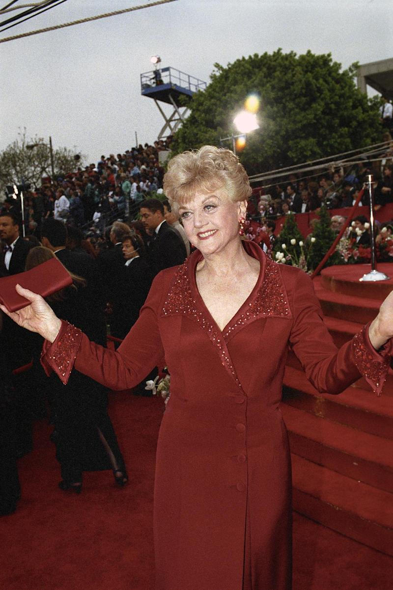 This 1992 photo released by the Academy of Motion Picture Arts and Sciences shows actress Angela Lansbury arriving at the 65th Academy Awards ceremony, in Los Angeles. The Board of Governors of the Academy of Motion Picture Arts and Sciences will present Honorary Awards to Lansbury, Steve Martin and Piero Tosi, and the Jean Hersholt Humanitarian Award to Angelina Jolie. All four awards will be presented at the Academy's 5th Annual Governors Awards on Saturday, November 16, 2013, at the Ray Dolby Ballroom at the Hollywood & Highland Center in the Hollywood section of Los Angeles. (AP Photo/Copyright A.M.P.A.S.)