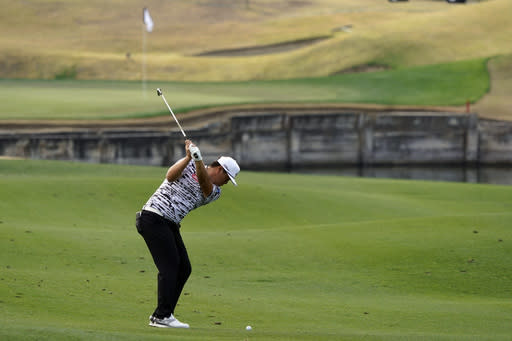 Sungjae Im hits from the seventh fairway during the second round of The American Express golf tournament on the Pete Dye Stadium Course at PGA West on Friday, Jan. 22, 2021, in La Quinta, Calif. (AP Photo/Marcio Jose Sanchez)