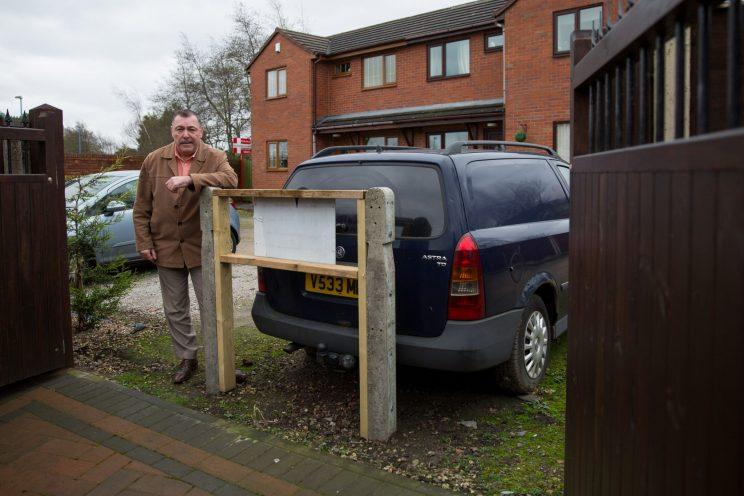 Nigel says his warring neighbour is wrong about the parking law (SWNS)