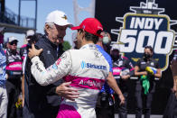 Roger Penske, left, owner of the Indianapolis Motor Speedway, congratulates Helio Castroneves, of Brazil, after Castroneves won the Indianapolis 500 auto race at Indianapolis Motor Speedway in Indianapolis, Sunday, May 30, 2021. (AP Photo/Michael Conroy)