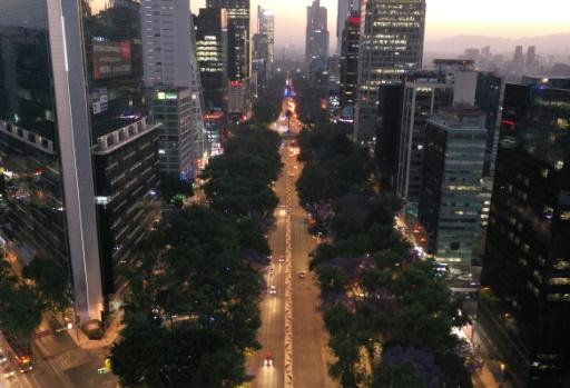 One of Mexico City's main arteries, Paseo de la Reforma, is nearly empty on the evening of March 23, 2020