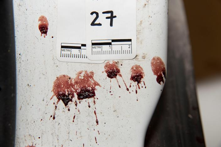 Bloodstains are seen next to a marker in the car of Philando Castile.
