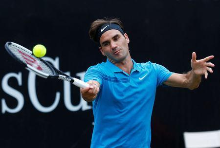 FILE PHOTO - Tennis Club Weissenhof, Stuttgart, Germany - June 17, 2018 Switzerland's Roger Federer in action during the final against Canada's Milos Raonic REUTERS/Ralph Orlowski