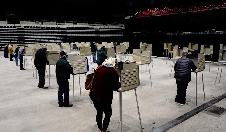 Voters complete their ballots at socially distanced privacy booths at an early voting site Monday inside the Bismarck Event Center as the coronavirus outbreak continues in North Dakota. Photo: Reuters
