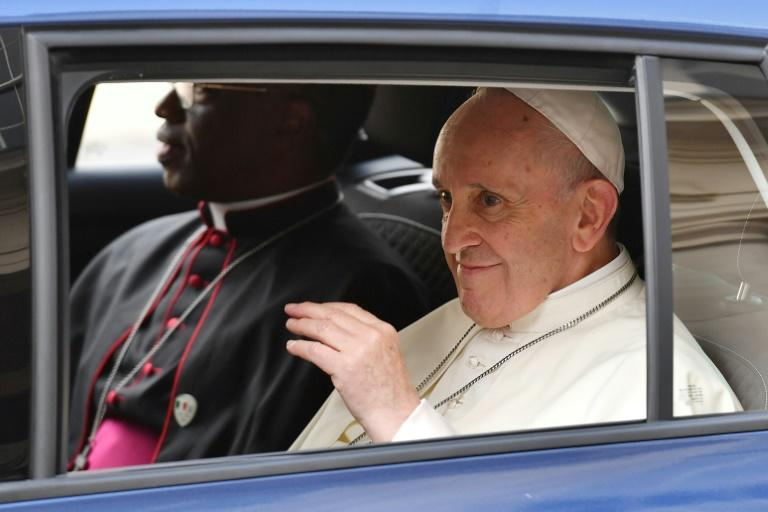 Supporters lined the streets outside Dublin Castle, cheering the pontiff as he waved back from the rear of a modest Skoda
