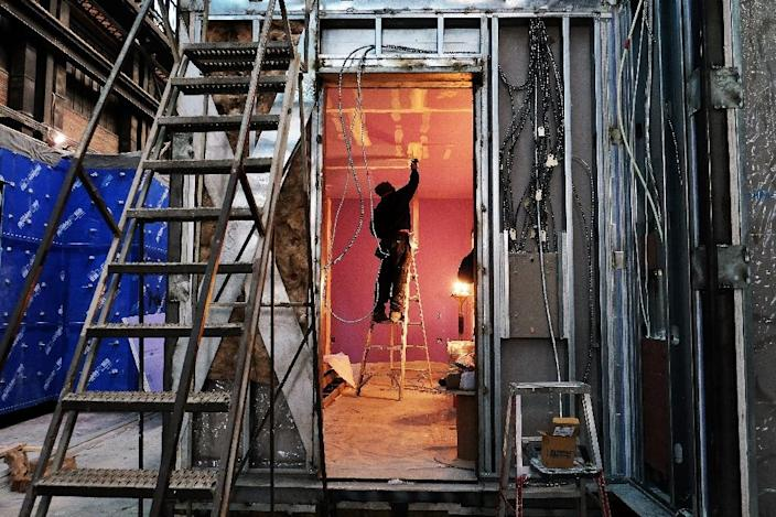 A worker paints the inside of a micro-unit at a Capsys Corp factory in Brooklyn, New York (AFP Photo/Jewel Samad)