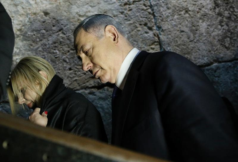 Israeli Prime Minister Benjamin Netanyahu and his wife leave after praying at the Western Wall in the Old City of Jerusalem, on March 18, 2015 (AFP Photo/Thomas Coex)