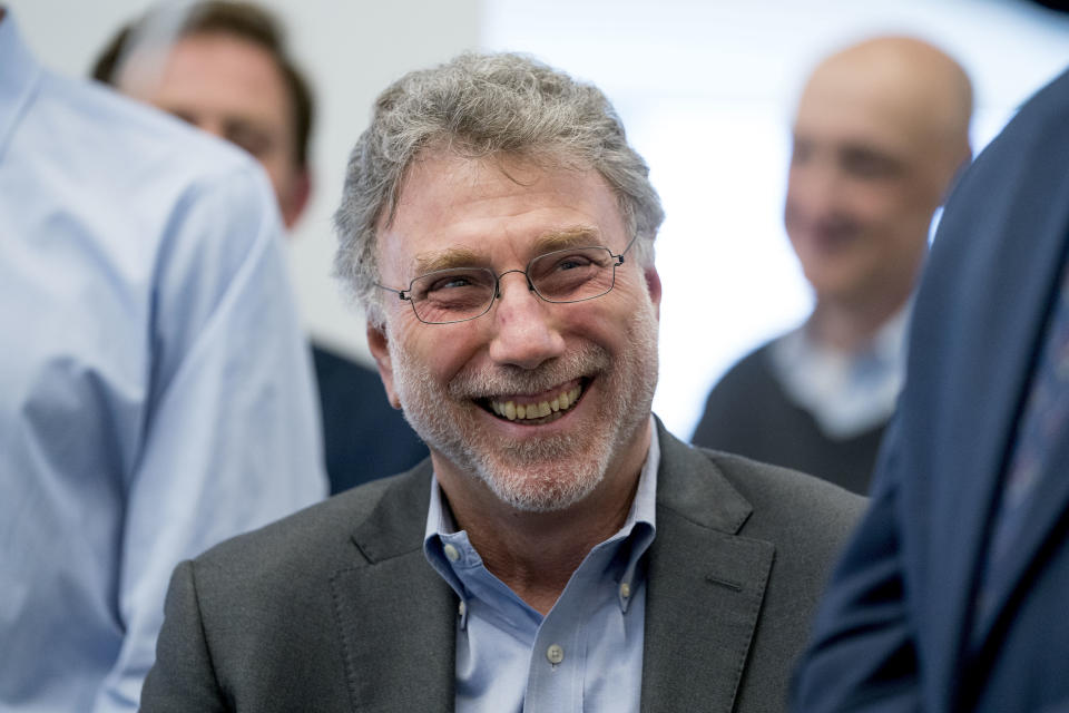 """FILE - Washington Post Executive Editor Marty Baron appears in the news room after winning two Pulitzer Prizes in Washington on April 16, 2018. Baron, executive editor of The Washington Post and one of the nation's top journalists, says he will retire at the end of February. He took over the Post's newsroom in 2012 after editing the Boston Globe and Miami Herald before that. He was portrayed in the 2015 movie """"Spotlight"""" about the Globe's investigation of the Catholic Church. (AP Photo/Andrew Harnik, File)"""