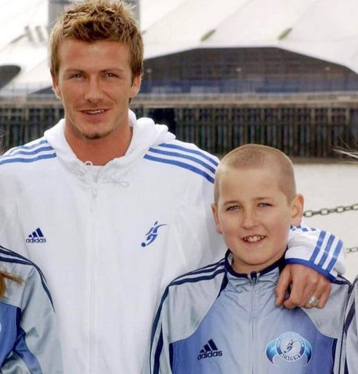 <p>Here's a current England striker pictured with David Beckham. </p>