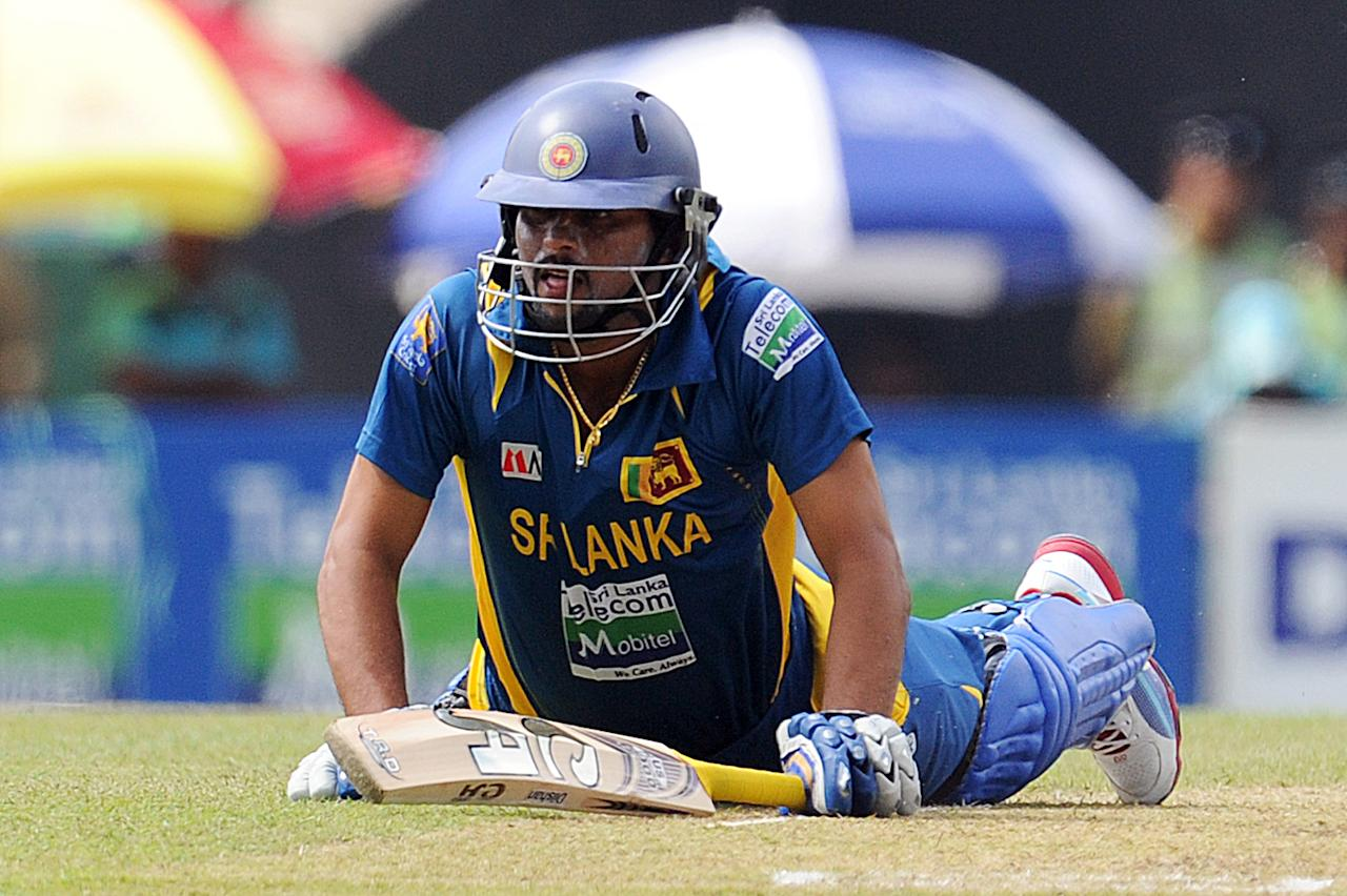 Sri Lankan cricketer Tillakaratne Dilshan dives to avoid being run out  during the third and final one-day international (ODI) match between Sri Lanka and Bangladesh at The  Pallekele International Cricket Stadium in Pallekele on March 28, 2013. AFP PHOTO/ Ishara S. KODIKARA        (Photo credit should read Ishara S.KODIKARA/AFP/Getty Images)