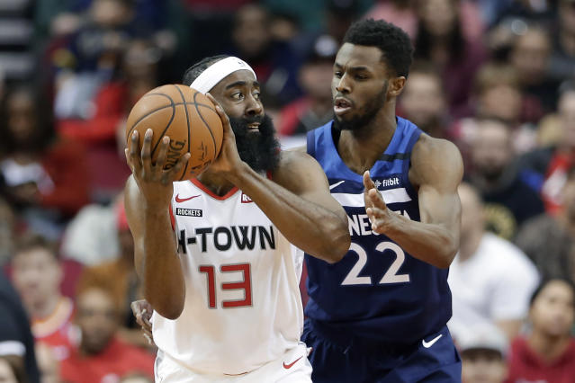 Houston Rockets guard James Harden (13) looks to pass the ball under pressure from Minnesota Timberwolves forward Andrew Wiggins (22) during the first half of an NBA basketball game Saturday, Jan. 11, 2020, in Houston. (AP Photo/Michael Wyke)