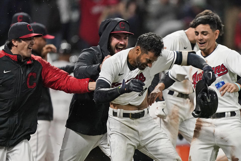 Cleveland Indians' Oscar Mercado, center, is mobbed by teammates after hitting a two-run home run in the seventh inning in the second baseball game of a doubleheader against the Chicago White Sox, Thursday, Sept. 23, 2021, in Cleveland. (AP Photo/Tony Dejak)