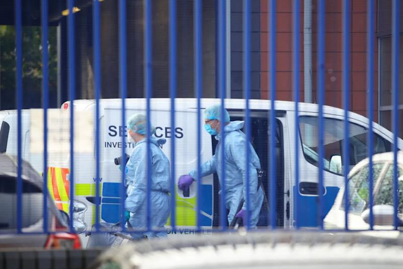 Forensics at the scene where the office was shot  (Photo: Press Association )