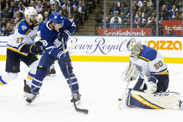 St. Louis Blues goaltender Jordan Binnington (50) makes a save in front of Toronto Maple Leafs right wing Mitchell Marner (16) during second-period NHL hockey game action in Toronto, Monday, Oct. 7, 2019. (Chris Young/The Canadian Press via AP)