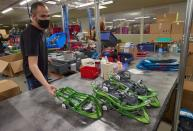 Staff assemble products at world biggest snowshoes maker TSL in Annecy-le-Vieux