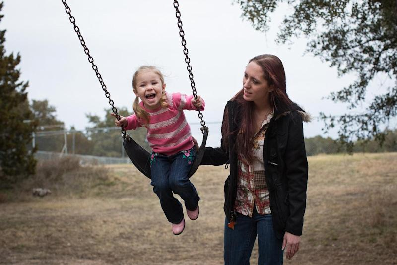 Maggie Barcellano plays with her three-year-old daughter, Zoe, at Lakeway City Park in Lakeway, Texas on Saturday, Jan. 25, 2014. Barcellano enrolled in the food stamps program to help save up for paramedic training while she works as a home health aide and raises her daughter. Working-age people now make up the majority in U.S. households that rely on food stamps, a switch from a few years ago when children and the elderly were the main recipients. (AP Photo/Tamir Kalifa)