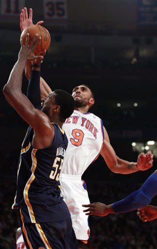 New York Knicks' Jared Jeffries (9) blocks a shot by Indiana Pacers' Roy Hibbert (55) during the first half of an NBA basketball game, Friday, March 16, 2012, in New York. (AP Photo/Frank Franklin II)
