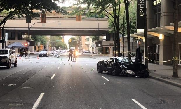 A damaged sports car is parked on Smithe Street in downtown Vancouver after a crash that killed a 23-month-old girl on July 6. (James Mulleder/CBC News - image credit)