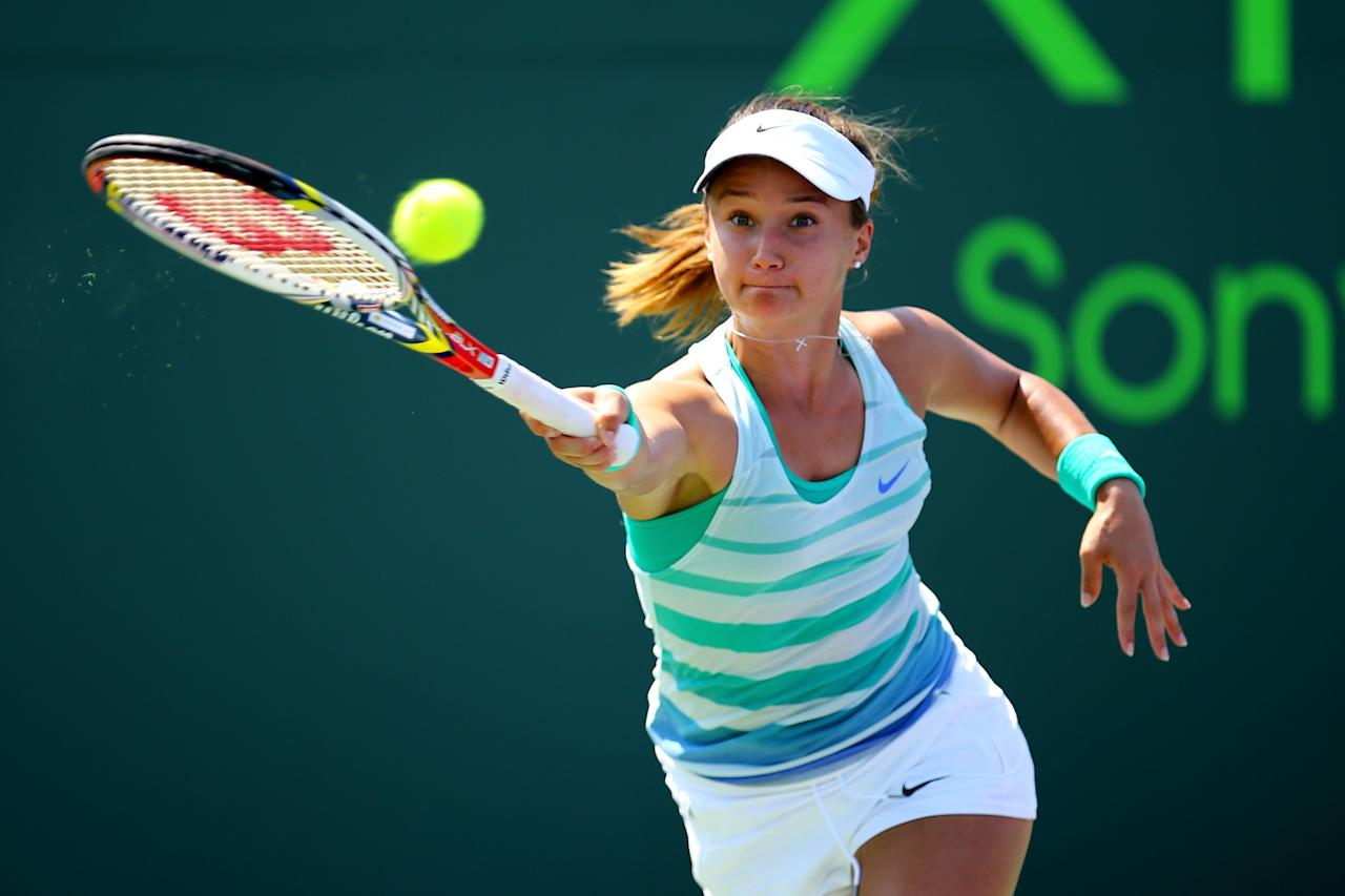 KEY BISCAYNE, FL - MARCH 24:  Lauren Davis of the USA returns a shot to Alize Cornet of France during Day 7 of the Sony Open at the Crandon Park Tennis Center on March 24, 2013 in Key Biscayne, Florida.  (Photo by Al Bello/Getty Images)