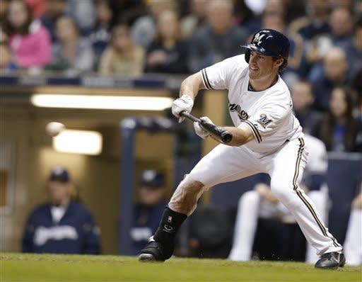 Milwaukee Brewers' Logan Schafer bunts to drive in a run against the Chicago Cubs during the sixth inning of a baseball game Saturday, April 20, 2013, in Milwaukee. (AP Photo/Jeffrey Phelps)