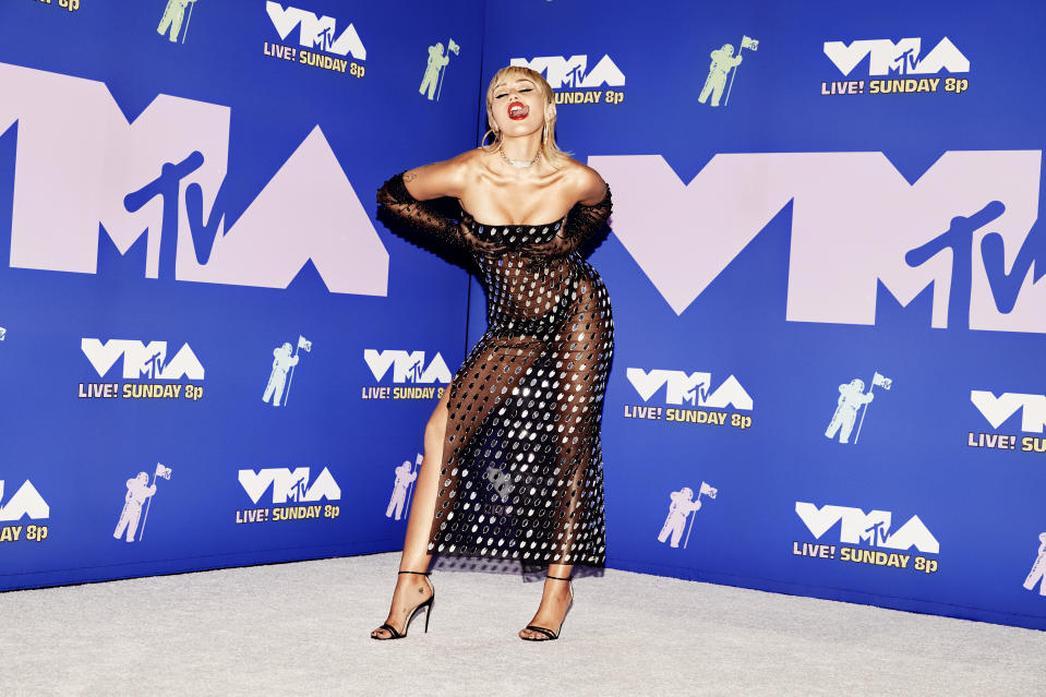 Miley Cyrus wears a sheer black Mugler dress on the red carpet at the 2020 MTV Video Music Awards, broadcast on Sunday, August 30, 2020 in New York City