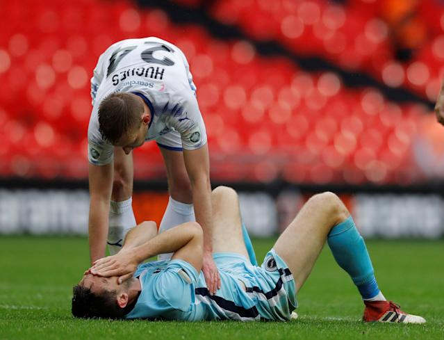 Soccer Football - National League Promotion Final - Tranmere Rovers v Boreham Wood - Wembley Stadium, London, Britain - May 12, 2018 Boreham Wood's Tom Champion is consoled by Tranmere Rovers' Jeff Hughes after the match Action Images/Andrew Couldridge