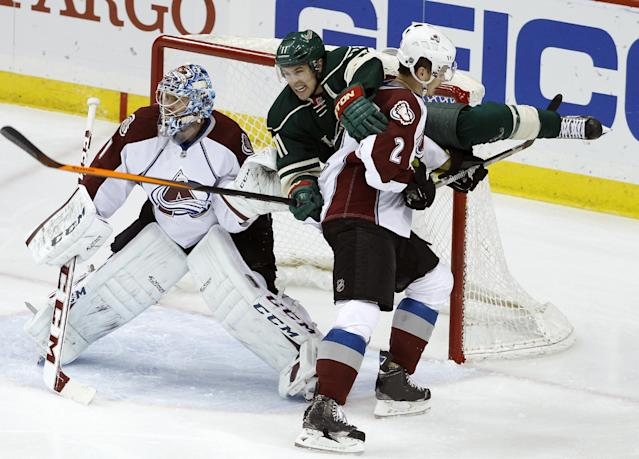 Colorado Avalanche defenseman Nick Holden (2) shoves Minnesota Wild left wing Zach Parise (11) into the net as Avalanche goalie Semyon Varlamov (1), of Russia, keeps his eyes on the puck during the first period of Game 4 of an NHL hockey first-round playoff series in St. Paul, Minn., Thursday, April 24, 2014. The Wild won 2-1. (AP Photo/Ann Heisenfelt)