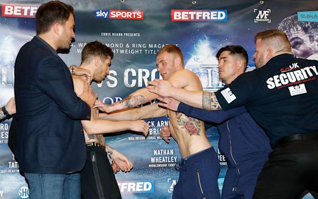<span>Brian Rose (left) and Jack Arnfield clash during their weigh-in</span> <span>Credit: pa </span>