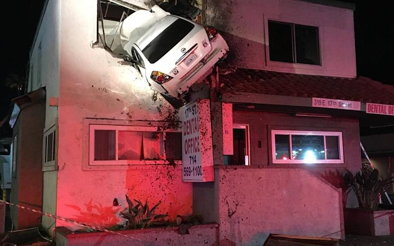 A Nissan crashed into the second floor of a building in Santa Ana early on Saturday - Cover Images