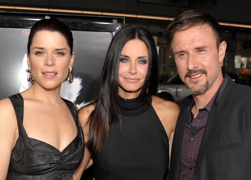 """(L-R) Actors Neve Campbell, Courteney Cox and David Arquette arrive at the world premiere of The Weinstein Company's """"Scre4m"""" presented by AXE Shower at Grauman's Chinese Theatre on April 11, 2011 in Hollywood, California. (Photo by John Shearer/WireImage)"""