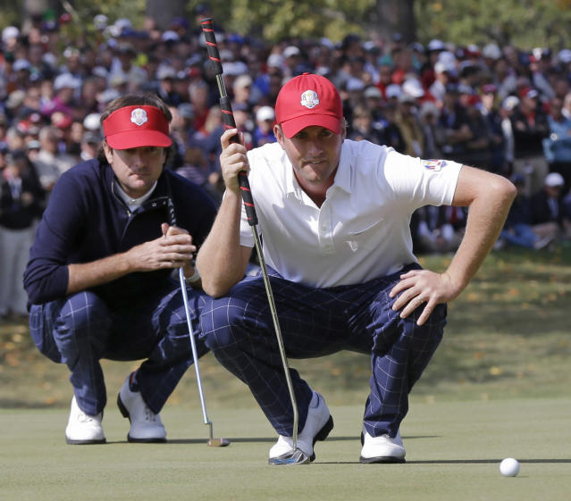 USA's Webb Simpson, right, and Bubba Watson line up a putt on the fifth hole during a four-ball match at the Ryder Cup PGA golf tournament Friday, Sept. 28, 2012, at the Medinah Country Club in Medinah, Ill. (AP Photo/David J. Phillip)