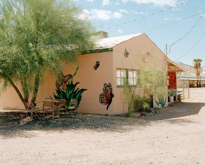 The exterior of the Ajo Humanitarian Aid Office is painted with murals of monarch butterflies, a symbol often used by immigrant rights advocates because of the insect's migratory patterns from Mexico to the United States.   Cassidy Araiza for TIME
