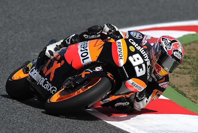 Team CatalunyaCaixa Repsol Spanish Marc Marquez takes a curve at the Catalunya racetrack in Montmelo, near Barcelona, on June 2, 2012, during the Moto2 qualifying session of the Catalunya Moto GP Grand Prix. AFP PHOTO/LLUIS GENELLUIS GENE/AFP/GettyImages