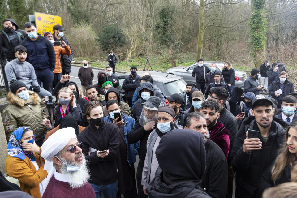 A local community leader speaks to the crowd of parents. Angry parents are protesting outside a Batley Grammar School, West Yorks, after a teacher allegedly showed derogatory caricatures of the Prophet Muhammad, pictured in West Yorks, March 25 2021. See SWNS story SWLEprotest.
