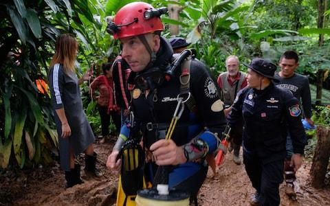British cave-diver Richard William Stanton walks out from Tham Luang Nang Non cave in full kit - Credit: Linh Pham /Getty