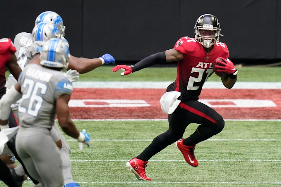 Falcons running back Todd Gurley (21) runs against the Lions during the first half on Sunday, Oct. 25, 2020, in Atlanta.