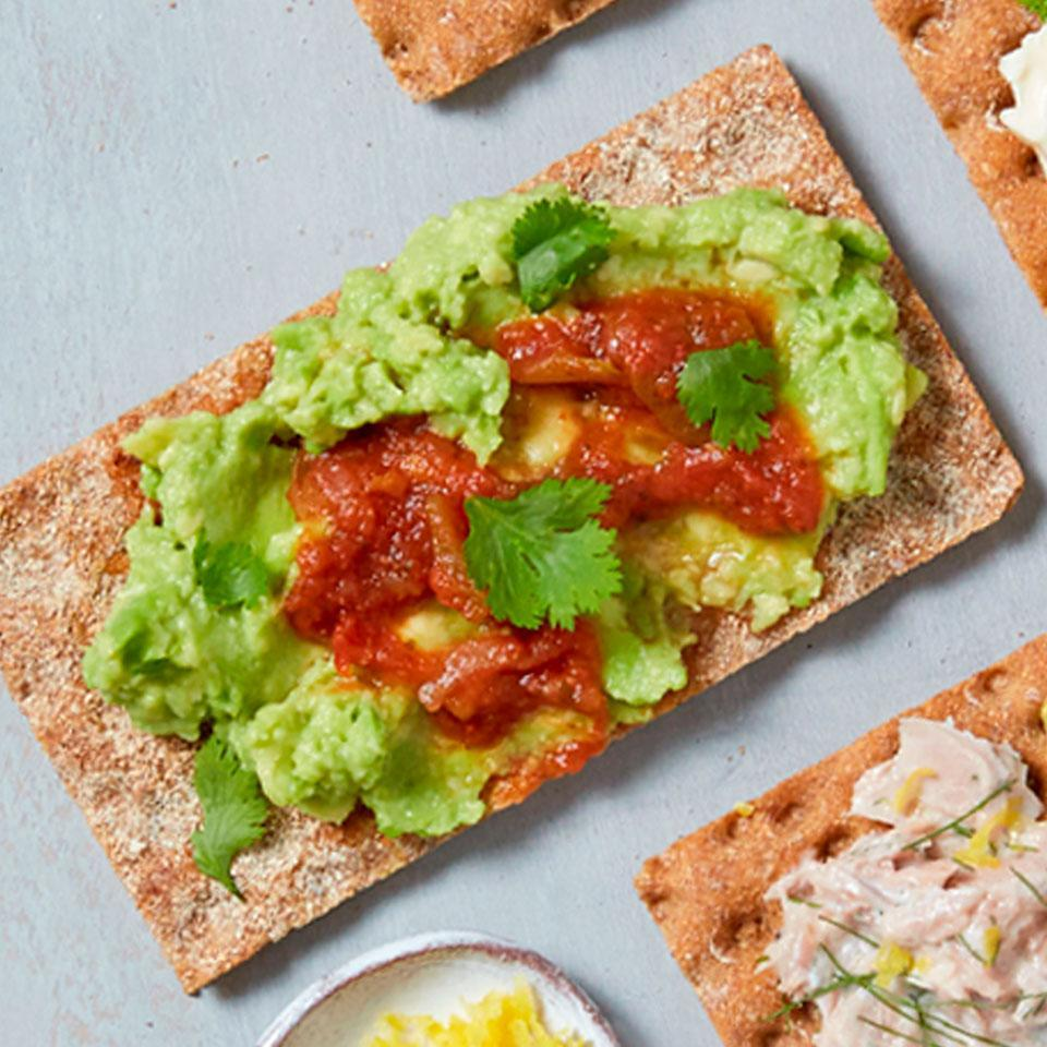<p>Avocado and salsa team up for a zesty Southwest-inspired topping on a whole grain crispbread. This snack is packed with fiber, veggies, and healthy fats, and it takes just minutes to put together.</p>