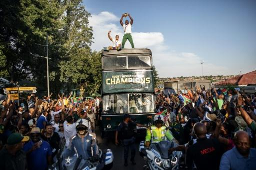 Kolisi stands proud on board the victory bus in Soweto