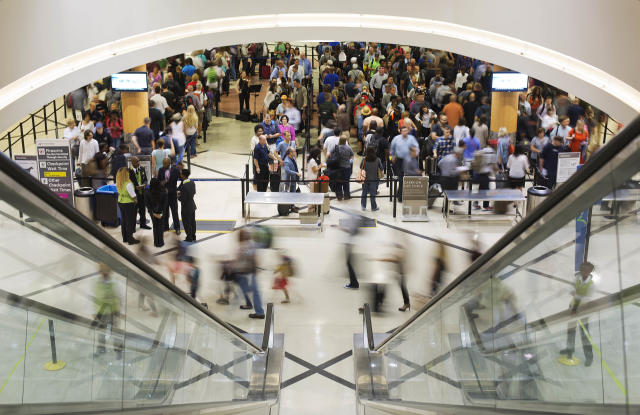 Travelers move through a security checkpoint line at Hartsfield-Jackson Atlanta International Airport