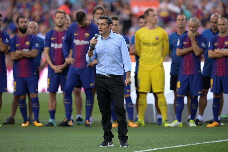 Barcelona's new coach Ernesto Valverde speaks to spectators ahead of a friendly match at the Camp Nou stadium in Barcelona, on August 7, 2017