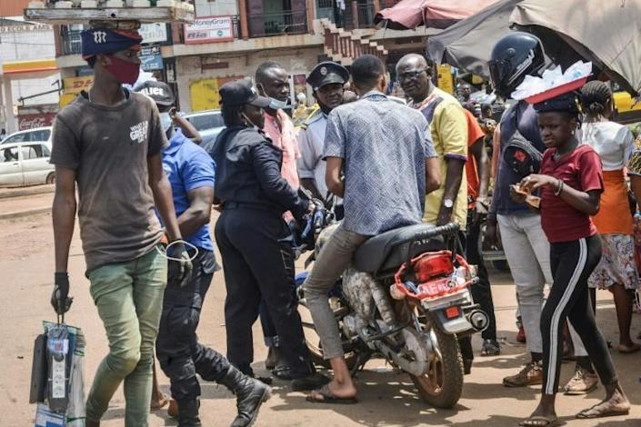 Two wheels bad: Police stop a motorcycle taxi driver in Conakry