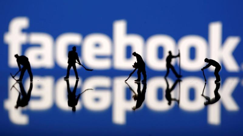 Figurines with pickaxes in front of the Facebook logo