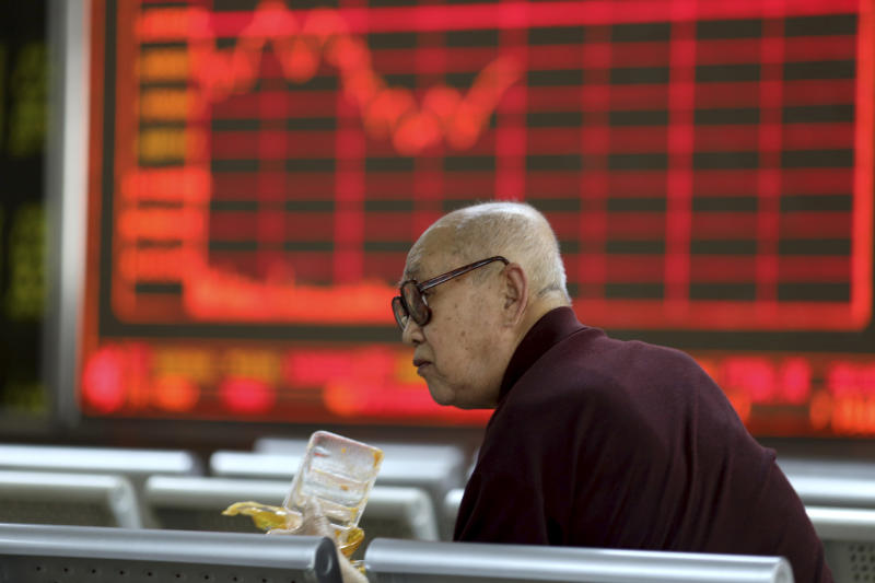 An investor finishes his meal at a stock brokerage in Beijing on Tuesday, April 23, 2019. Asian stocks were mixed on Tuesday while oil prices soared to their highest level since October after the U.S. said it would soon impose sanctions on all buyers of Iranian oil. (AP Photo/Ng Han Guan)