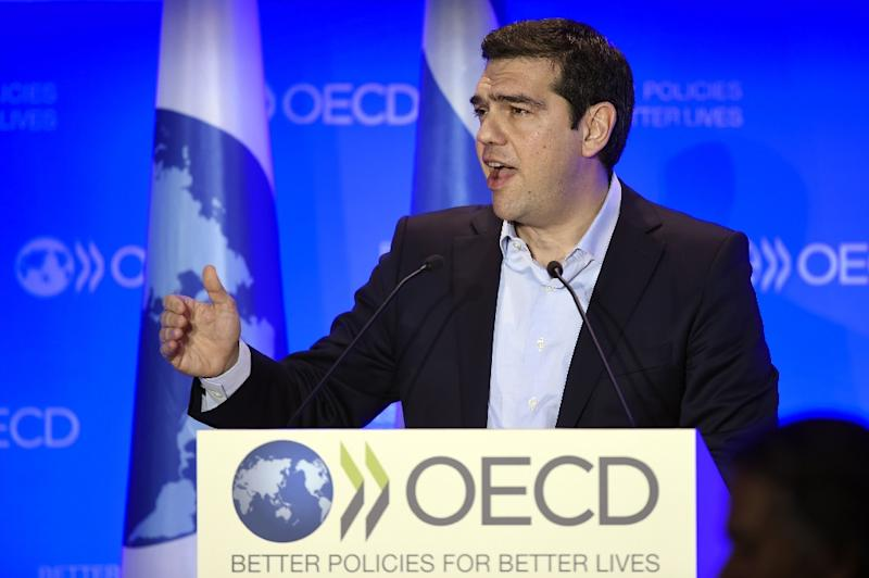 Greek Prime Minister Alexis Tsipras delivers a speech during his visit to the OECD headquarters in Paris, on March 12, 2015 (AFP Photo/Eric Feferberg)