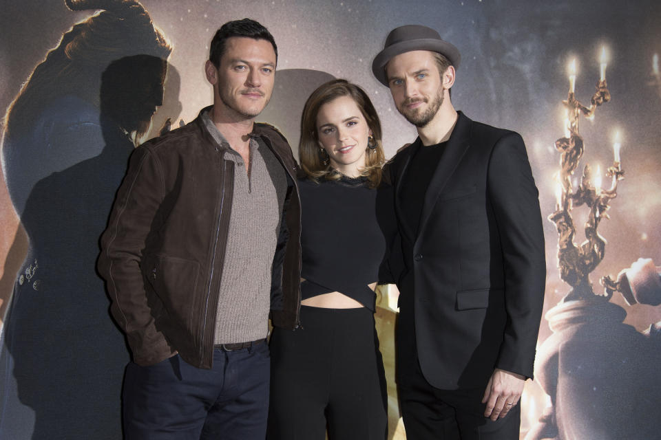 Actors from left, Luke Evans, Emma Watson and Dan Stevens pose for photographers during a photo call for the Beauty And The Beast Premiere, in London, Friday, Feb. 24, 2017. (Photo by Joel Ryan/Invision/AP)