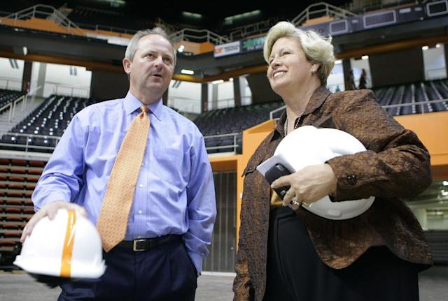 FILE - In this Oct. 17, 2007, file photo, then-Tennessee men's athletic director Mike Hamilton, left, and then-women's athletic director Joan Cronan talk during a tour of the newly renovated Thompson-Boling Arena in Knoxville, Tenn. With retirement looming at the end of the month, Cronan remains confident about the future of the Lady Vols brand even as the school where she's spent the last three-plus decades faces adversity in the wake of consolidating its men's and women's athletic departments. (AP Photo/Wade Payne, File)